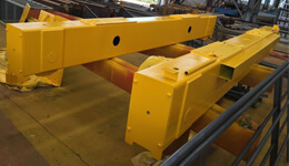 What is the bridge crane end carriage?